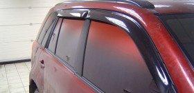 На фото - цветная тонировка автомобиля, extracar.ru