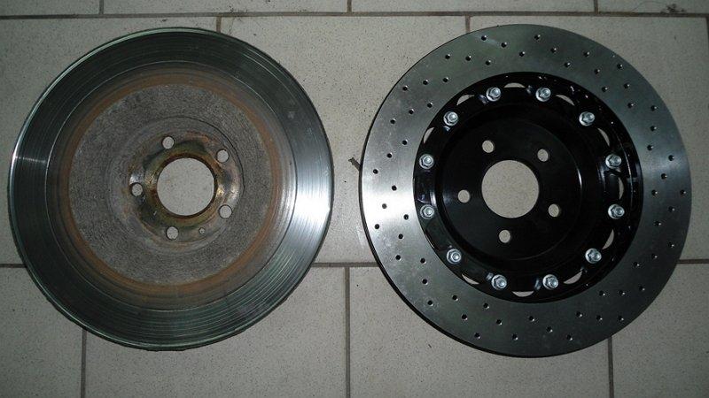 На фото - новый и изношенный тормозные диски