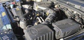 На фото - под капотом установлена турбина двигателя, bodylogicuk.com