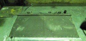 На фото - нуждающийся в чистке радиатор двигателя, esportby.com