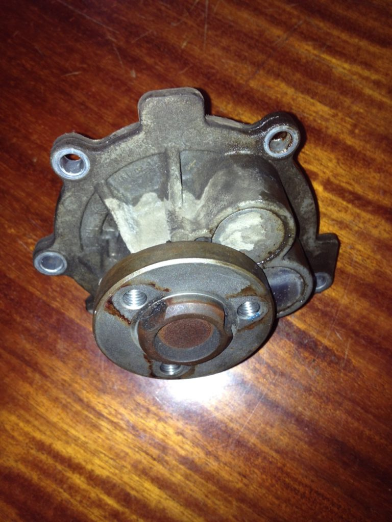 Старая помпа Opel Astra H